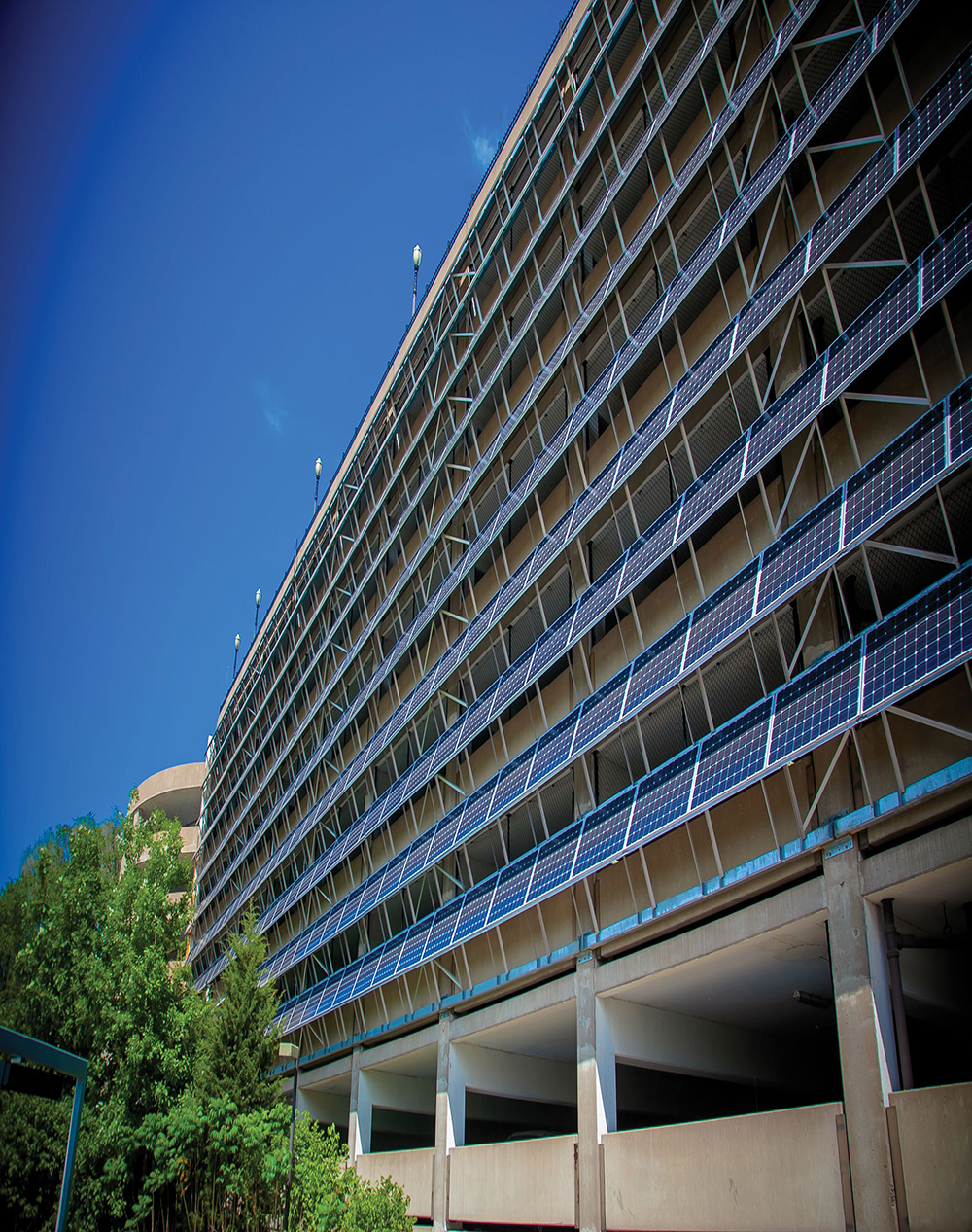 Supported by a steel frame, Hunt Electric mounted and connected 348 solar panels on the St. Paul River Centre parking ramp in Minnesota.