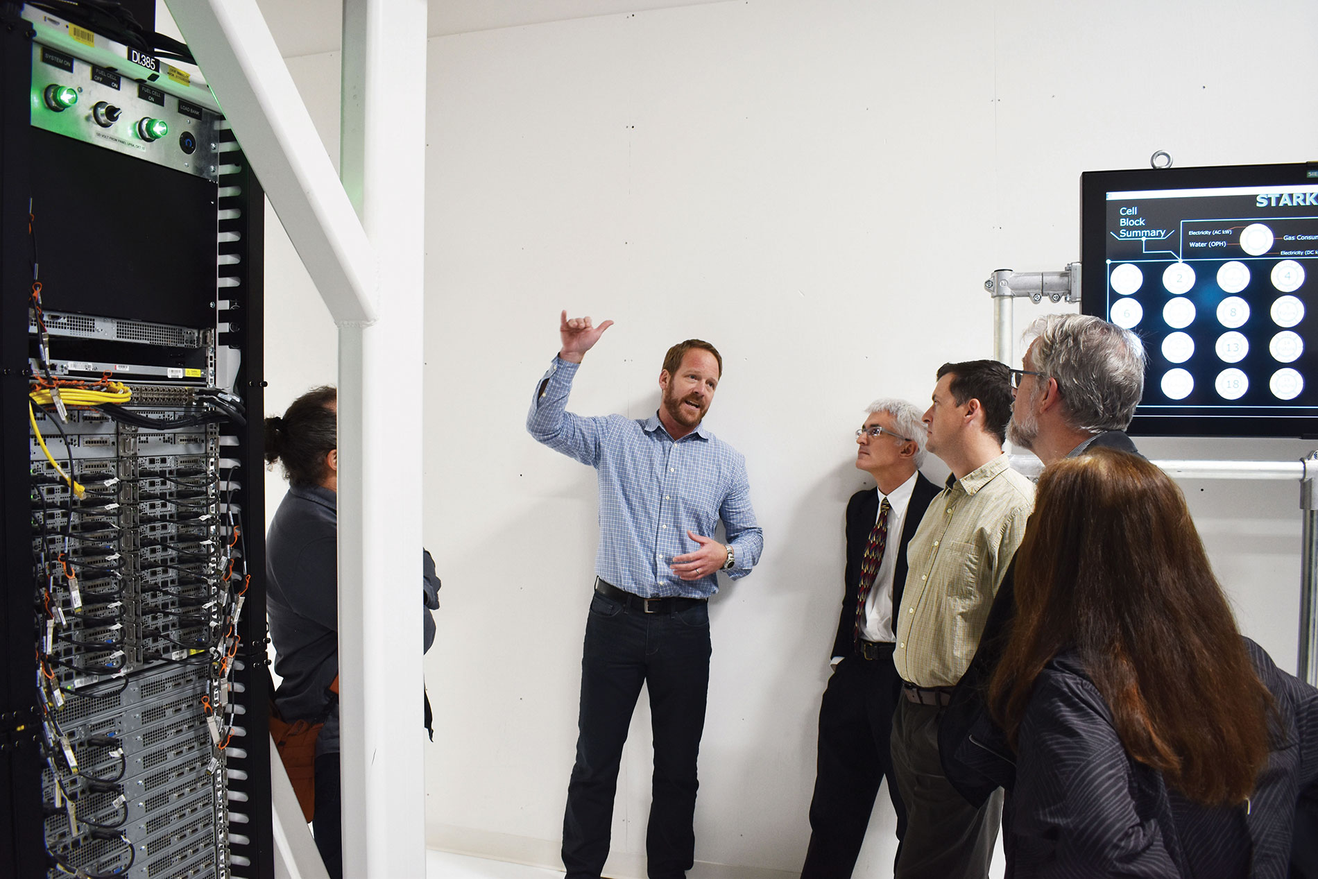 McKinstry's Dan Ronco demonstrates energy features in the Advanced Energy Lab data center.