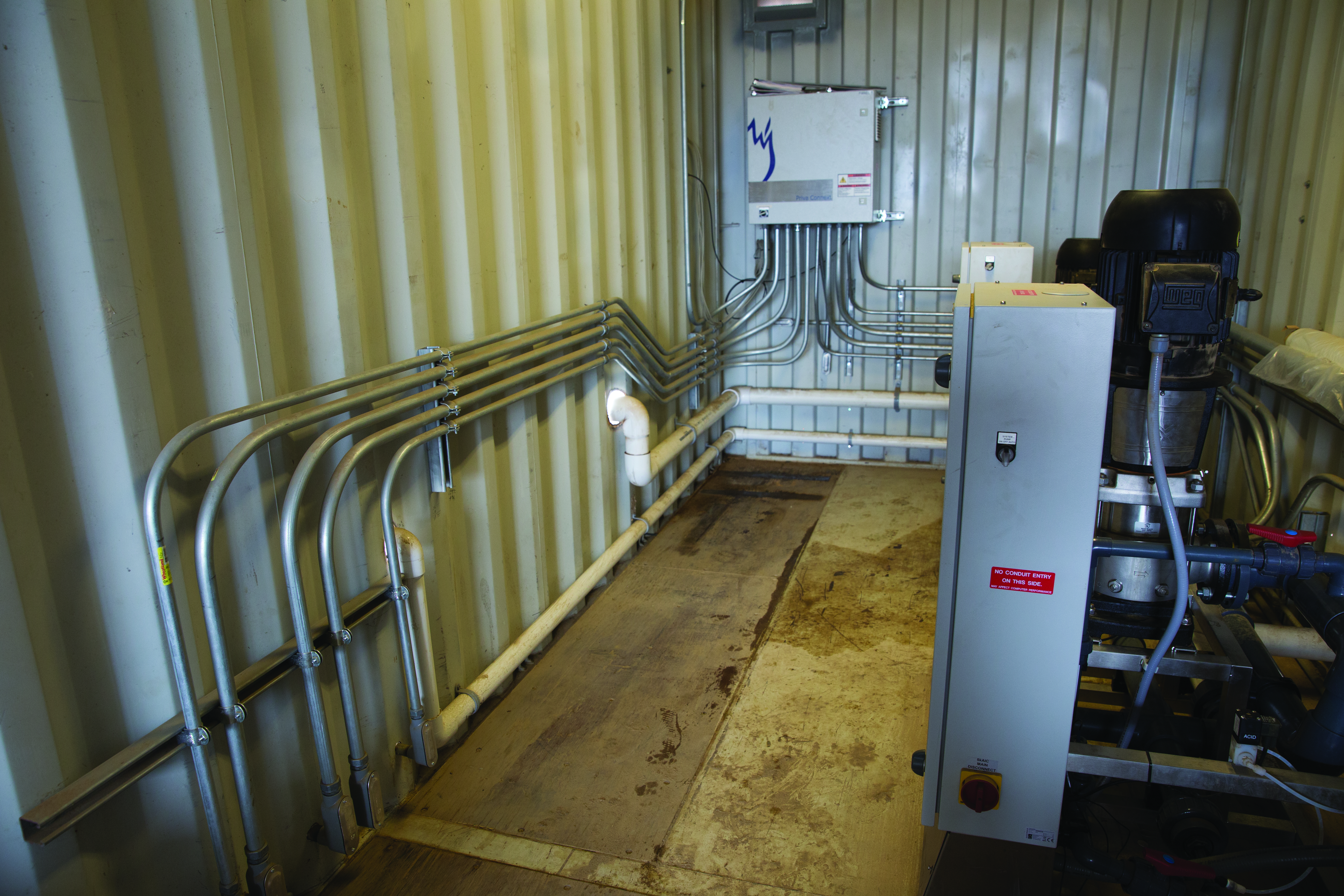 A climate-controlled Priva container houses the pump and control panel.