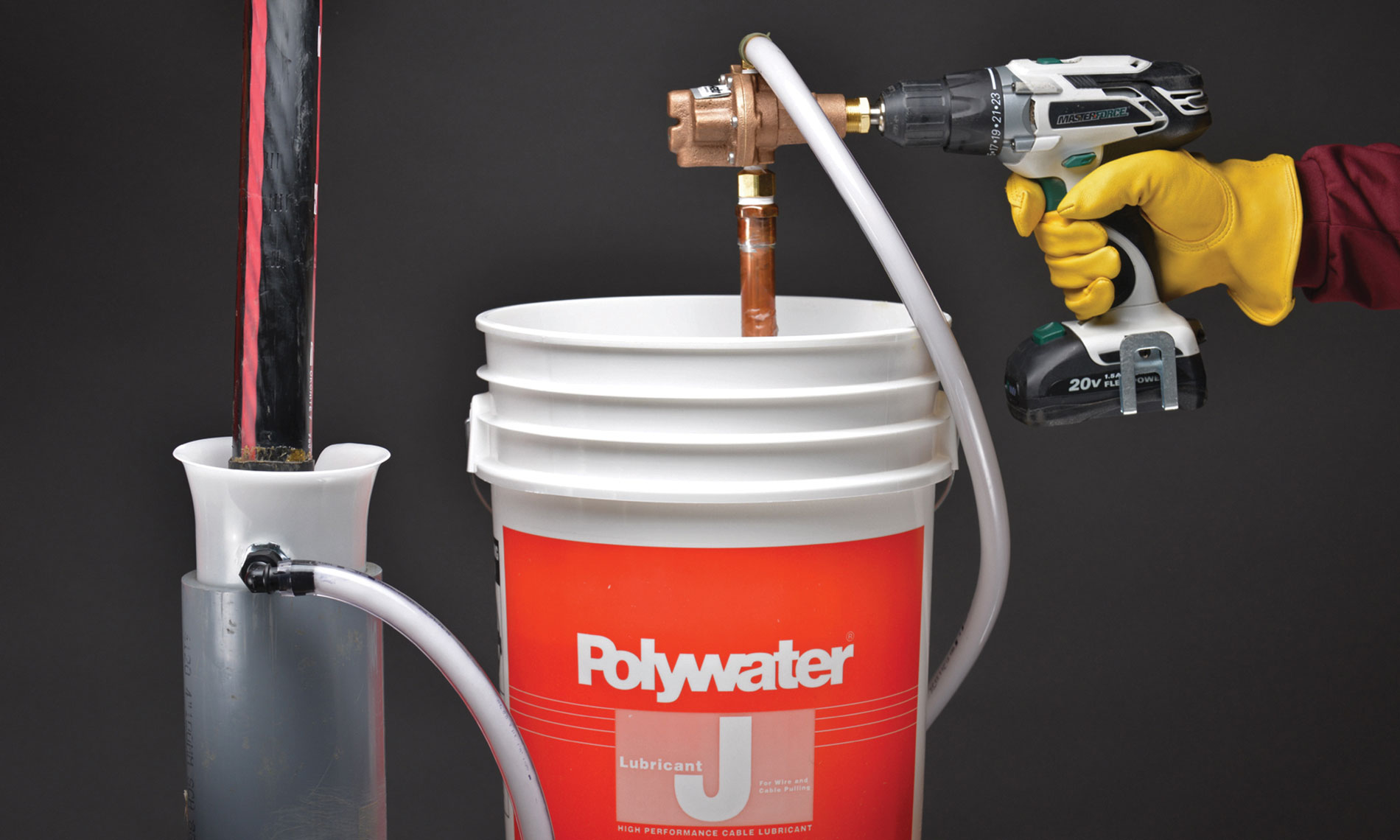 Polywater J cable pulling lubricant is deployed with the Polywater LP-D5 lubricant pump, which runs off a battery-powered drill and evenly coats cables throughout the cable pull.