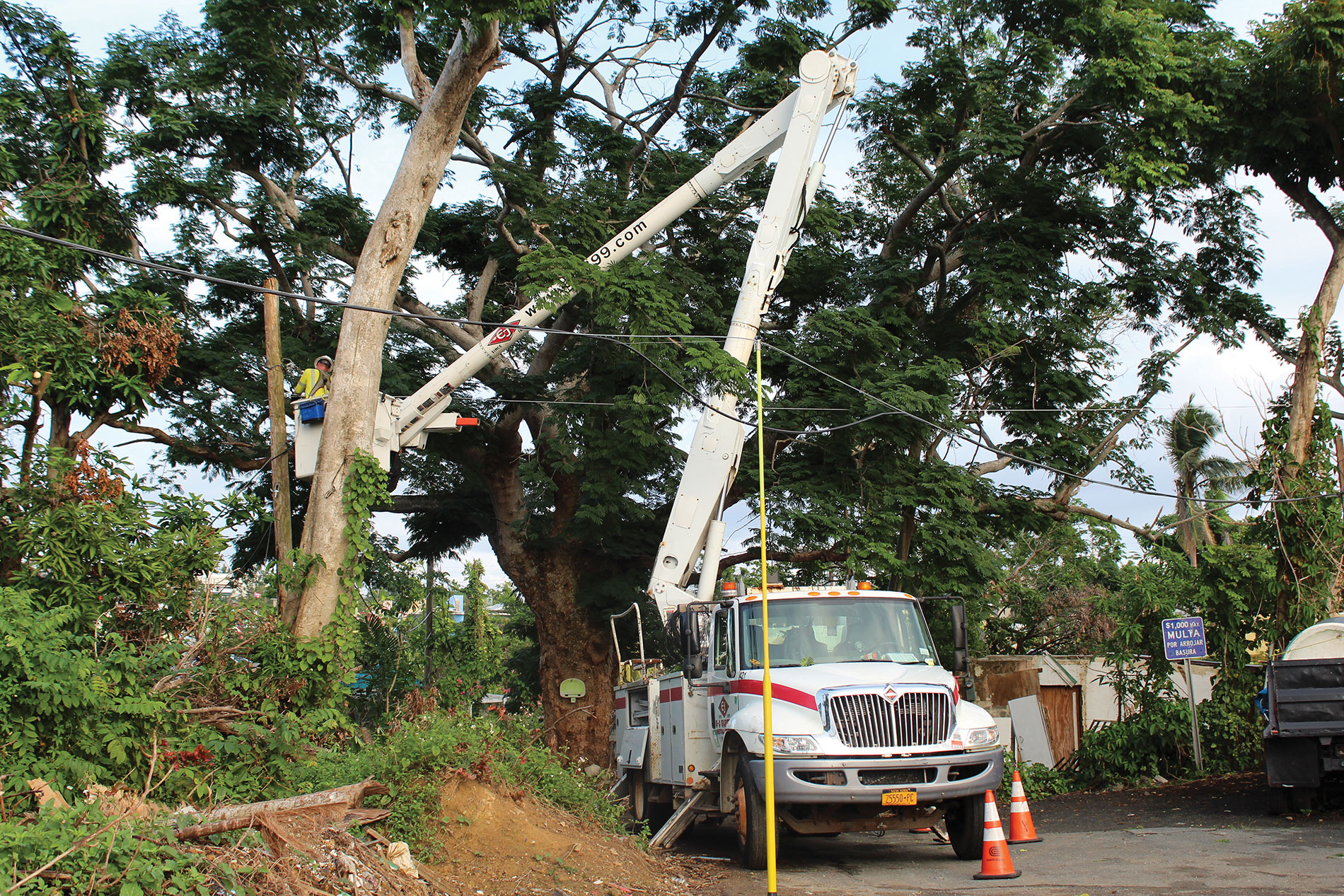 Pole locations added challenges to an already difficult assignment for  E-J Electric T&D crews in Puerto Rico. Credit: Joe Lunardi Electric Co.