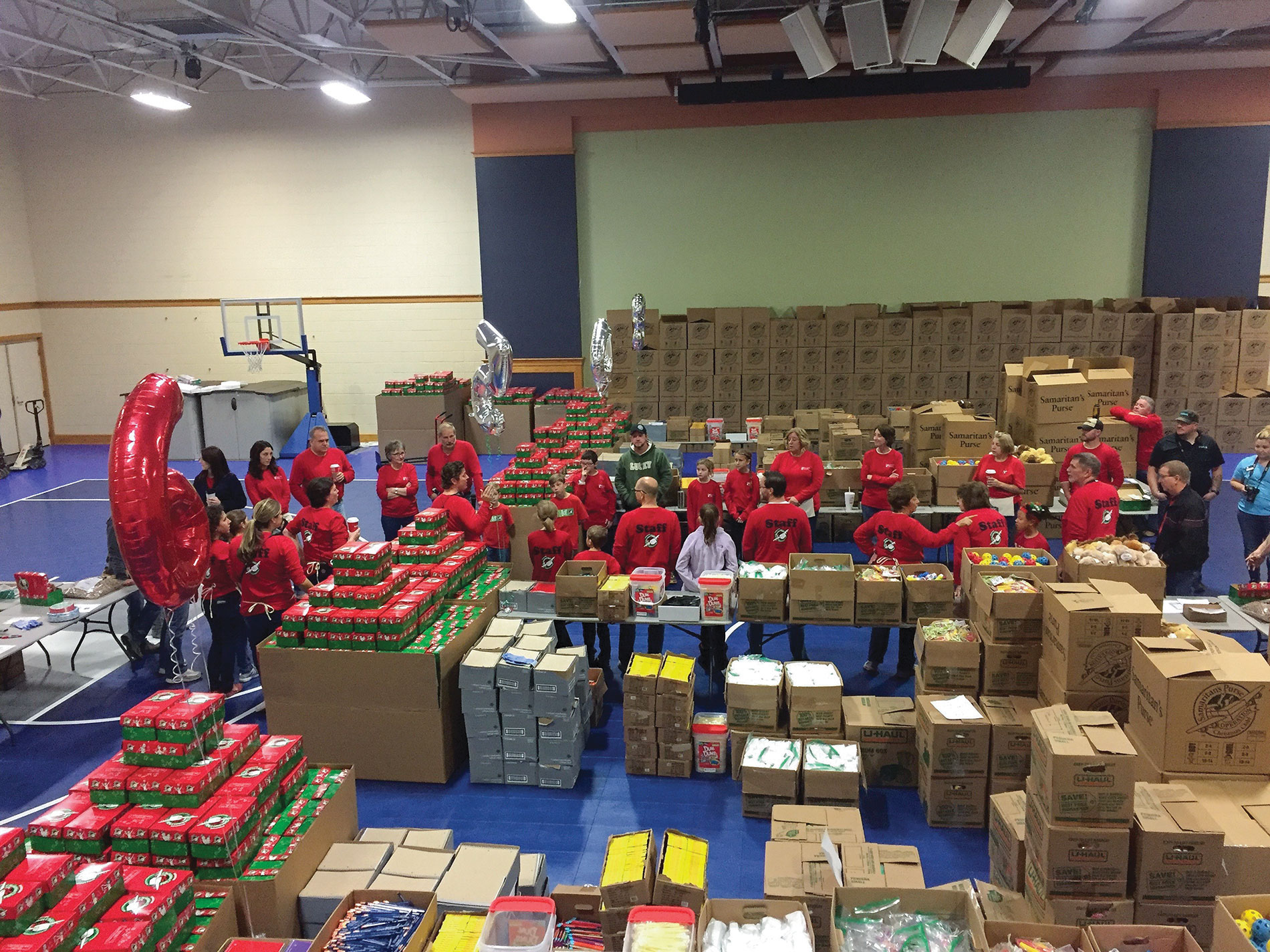 The Lighthouse Electric team recently prepared more than 10,000 gift-filled shoeboxes for children in need worldwide through Operation Christmas Child. Photo Credit: Lighthouse Electric