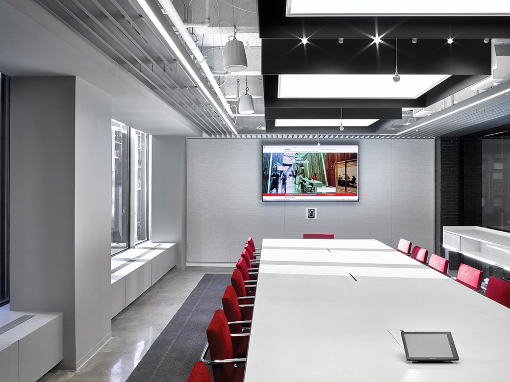 This conference space uses the IoT for lighting, air quality, temperature and A/V control. IEEE P2413 provides an architectural framework for cross-domain IoT installations.