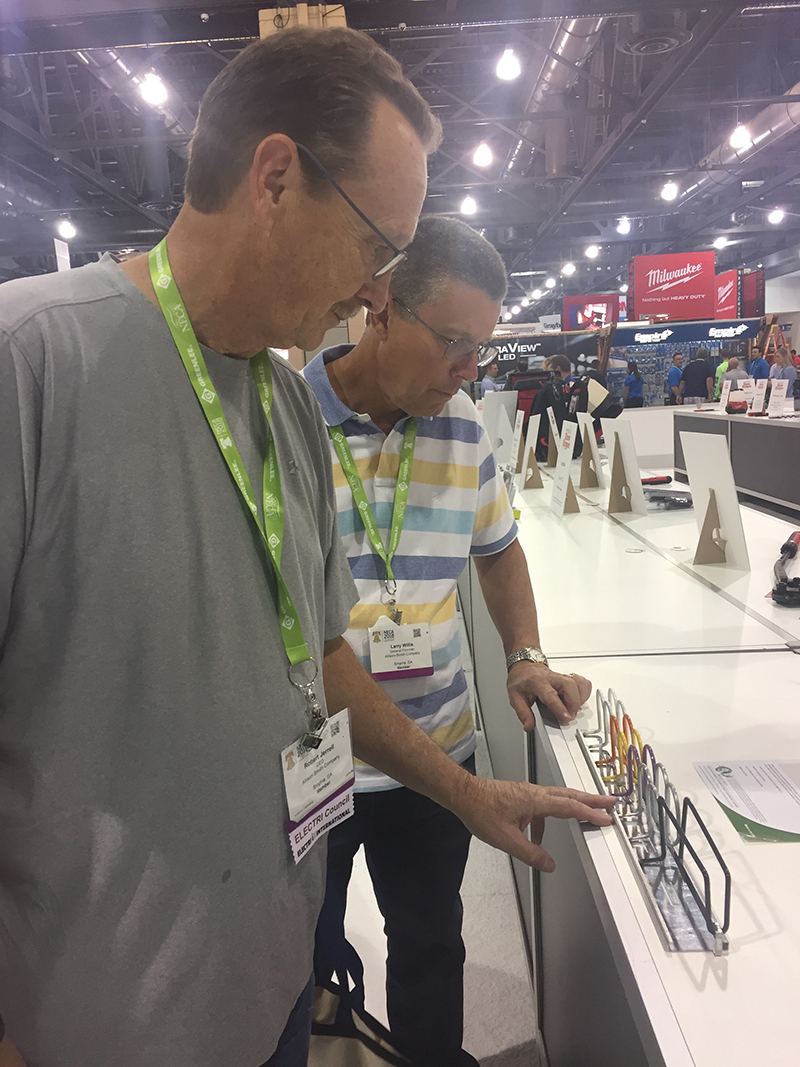 Robert Jerrell, CEO, and Larry Willis, General Foreman, of the Allison-Smith Company, Smyma, Ga., inspect a product by Snake Tray.