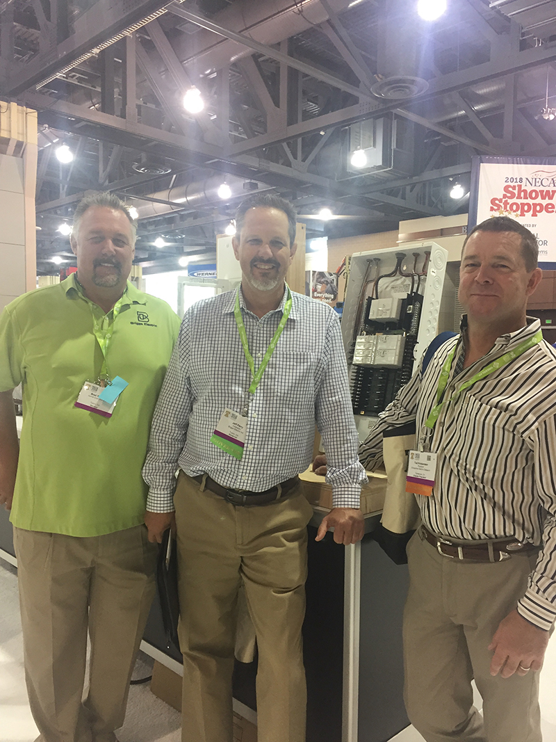 Ted Kristensen, Jeffy Perry, a contractor with Briggs Electric, Tustin, Calif., and Brad Weaver, a general superintendent, Tustin, Calif., with a Leviton circuit breaker.