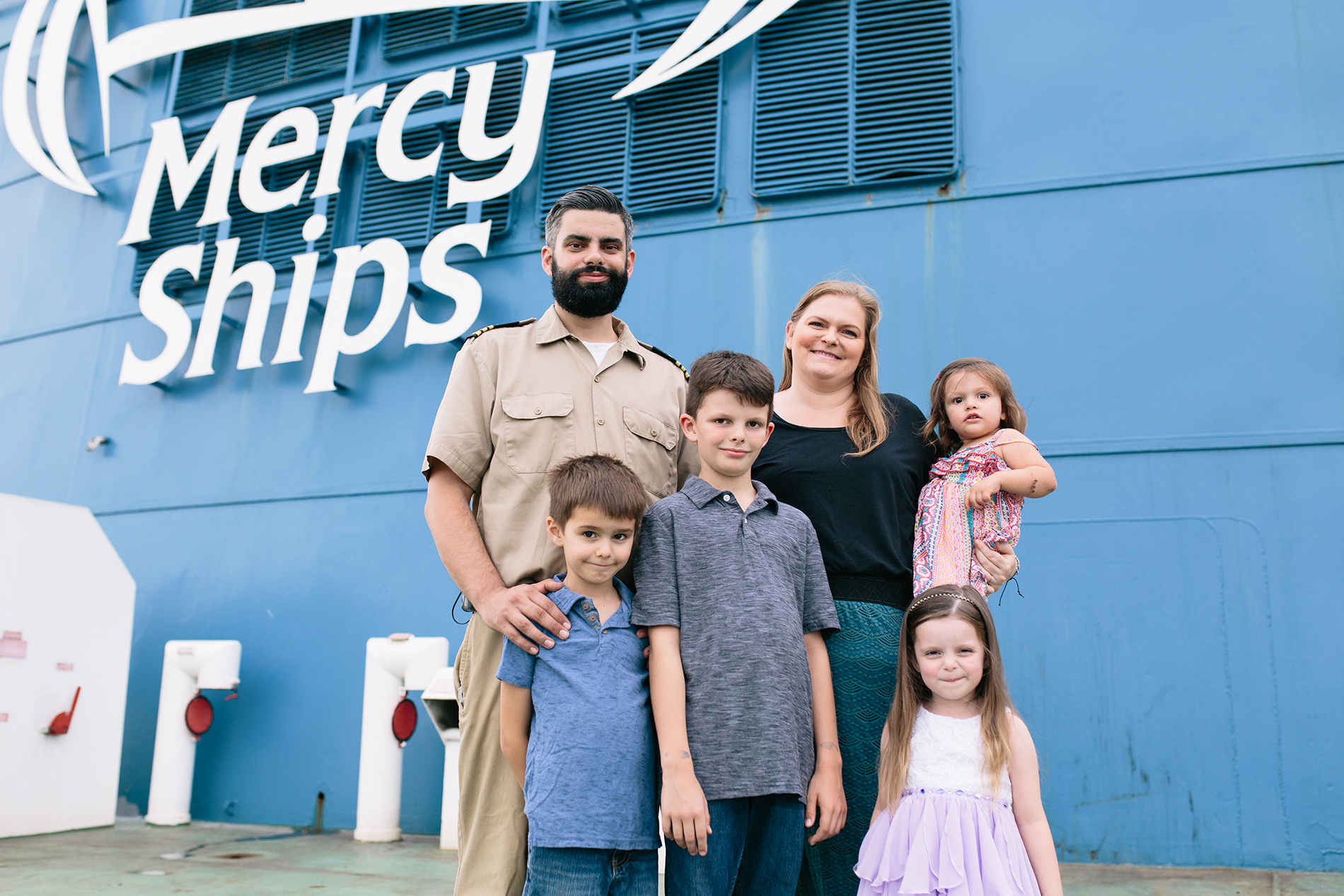 Justin and Jenni Brunenkant with their four children onboard the Africa Mercy. ©Mercy Ships, credit/ Shawn Thompson