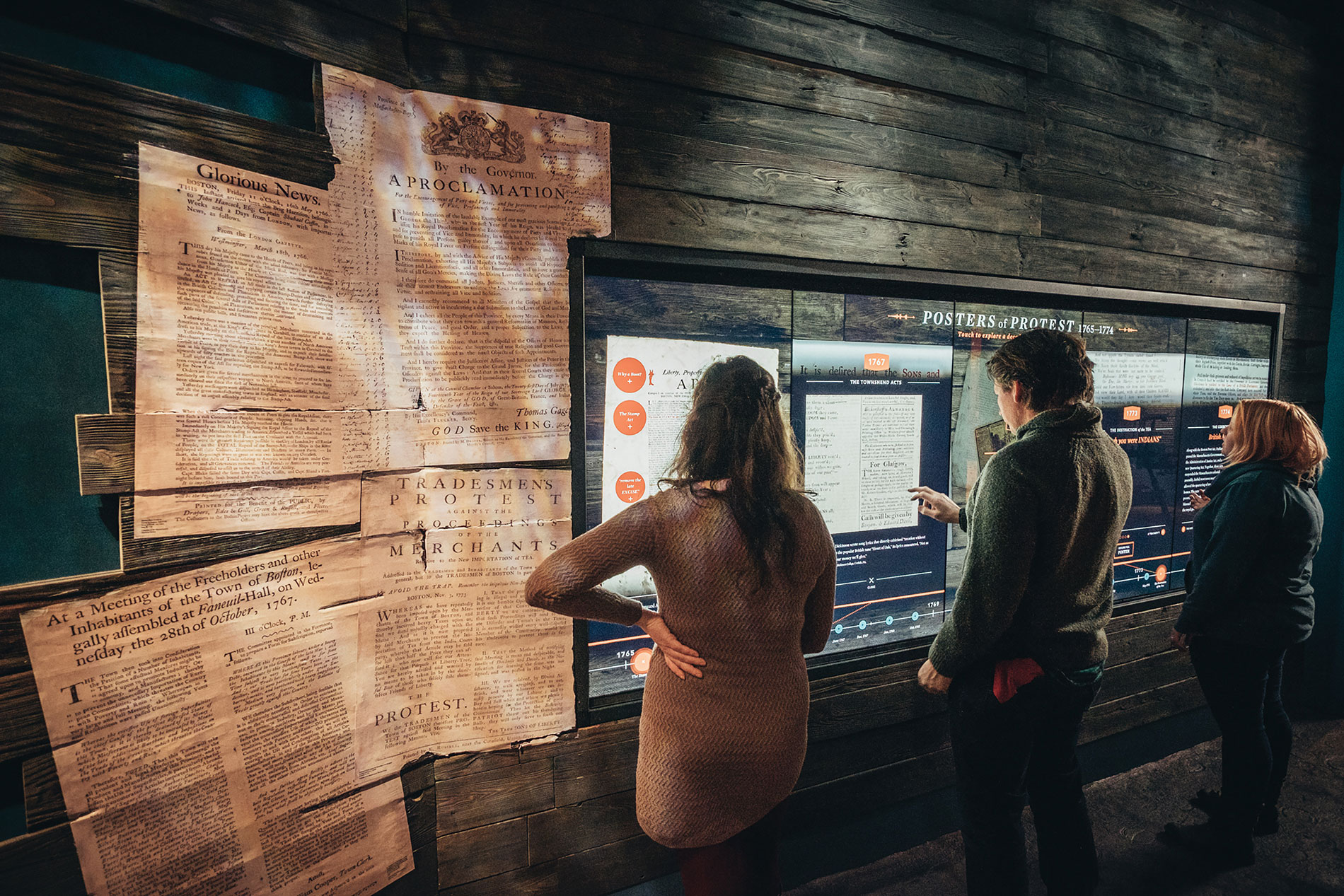 Visitors explore the origins of the Revolution with interactive exhibits.