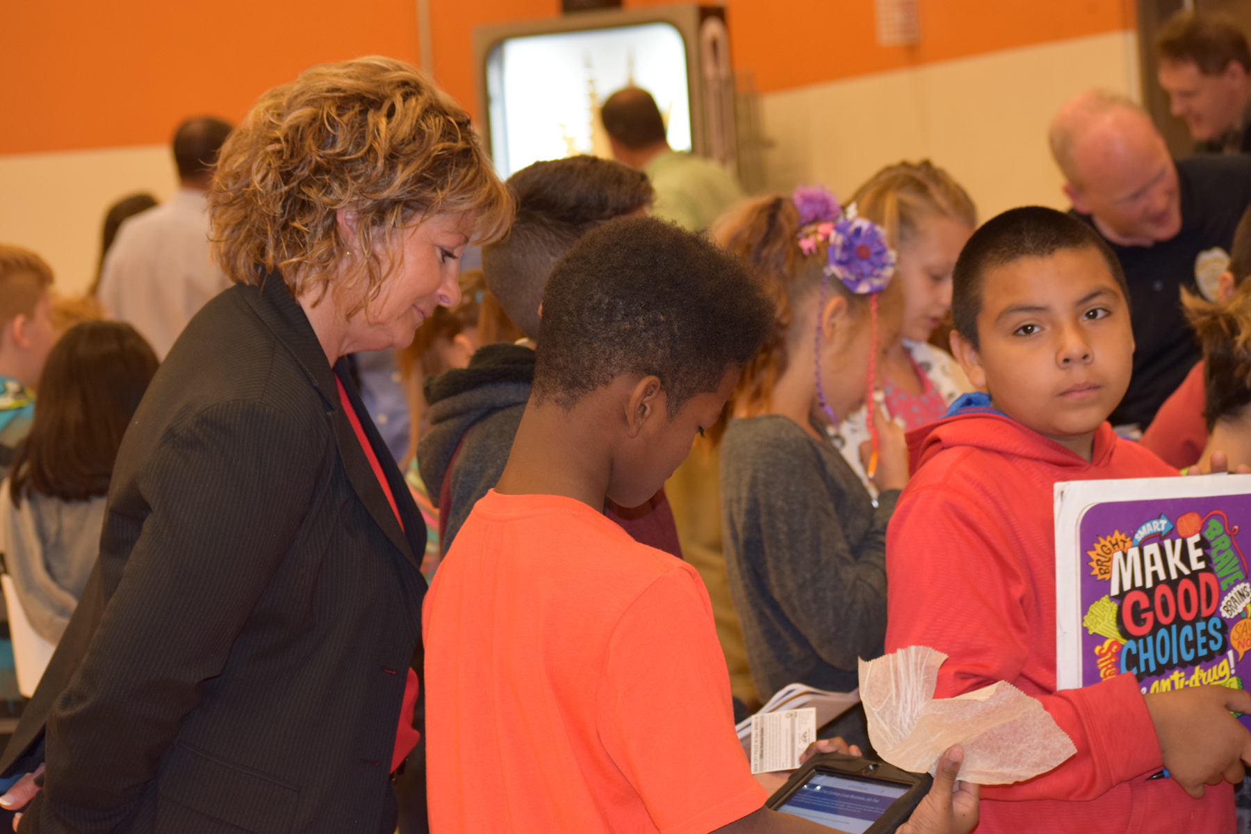Renee Beaulieu, CFO of Thompson Electric, has a student explain how they use their iPads for assignments.