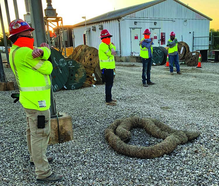 Michels Corp. employees participate in a morning stretch-and-flex session on a job site in Texas. | Michels Corp.