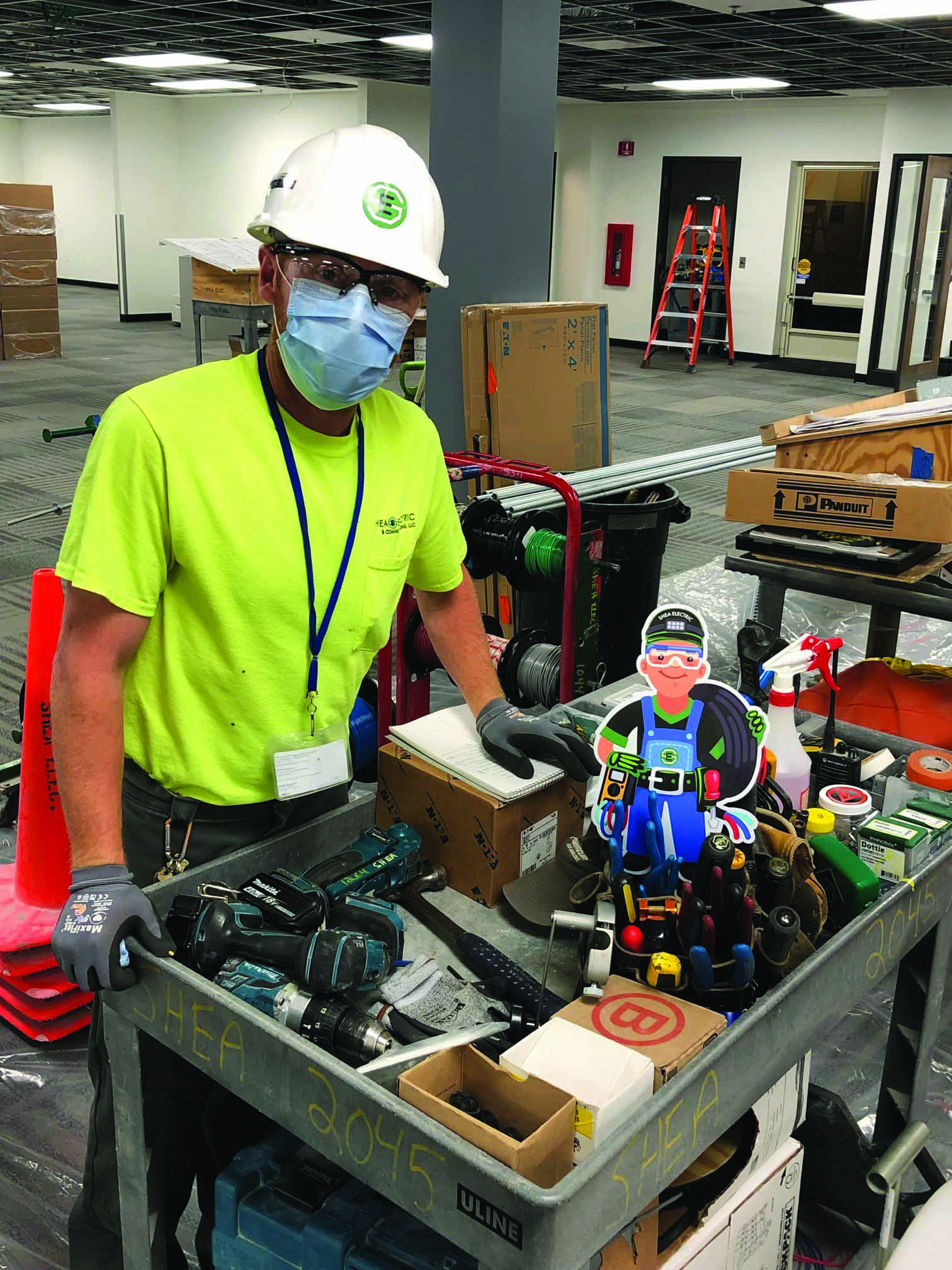 A Shea Electric employee dons PPE to enhance safety on the job during the pandemic. | Shea Electric