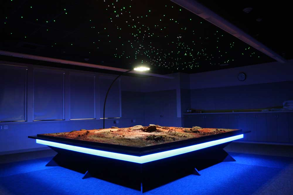 Simulated Mars landscape with starfield sky created by fiber optics.