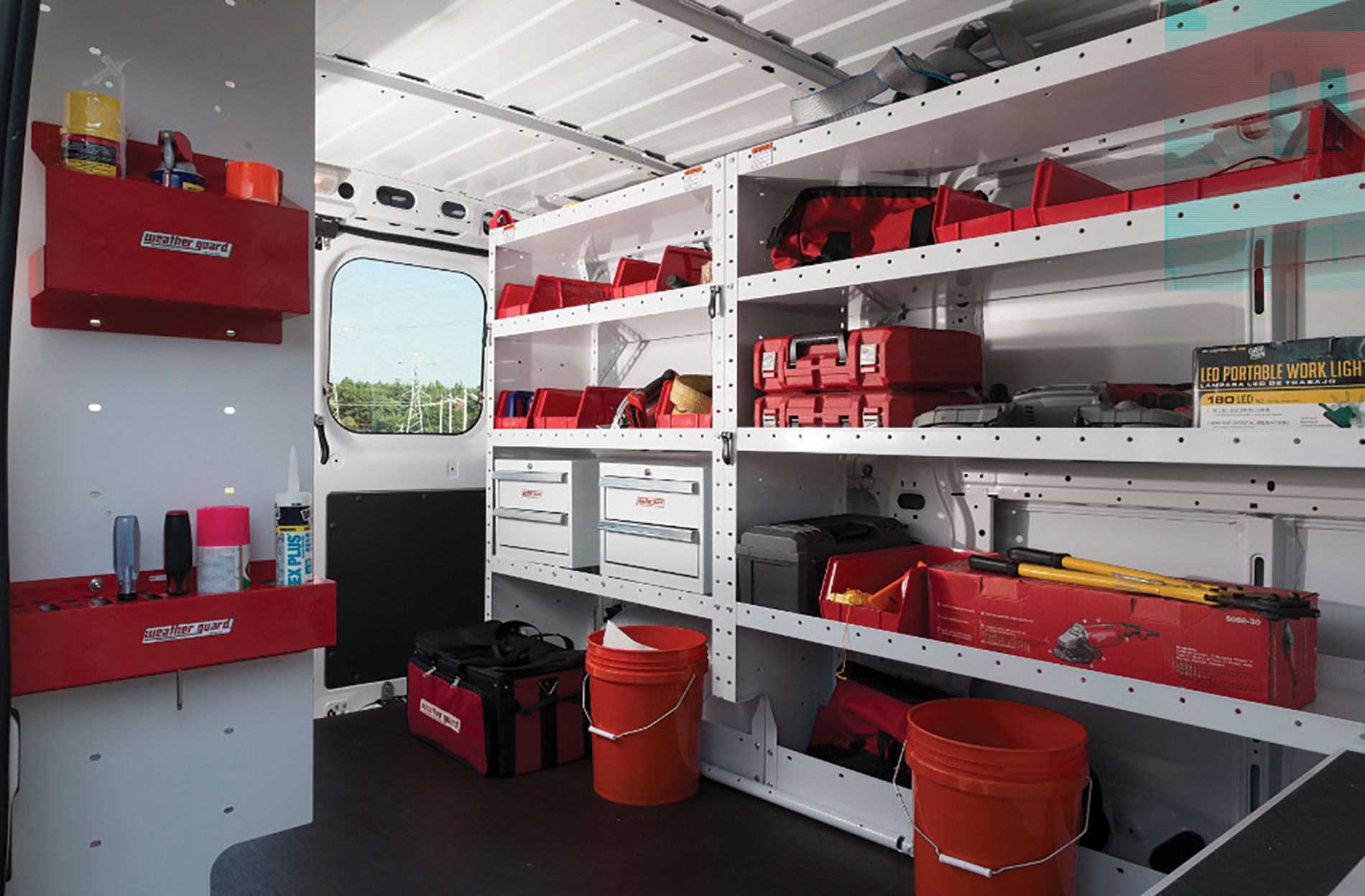 WeatherGuard interior van uplift includes shelves and drawers for small items.