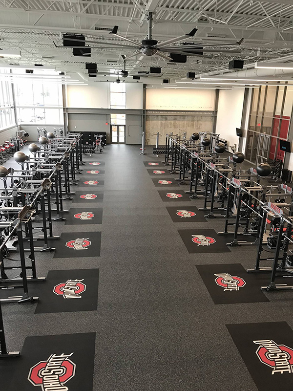 Weight room with speakers overhead