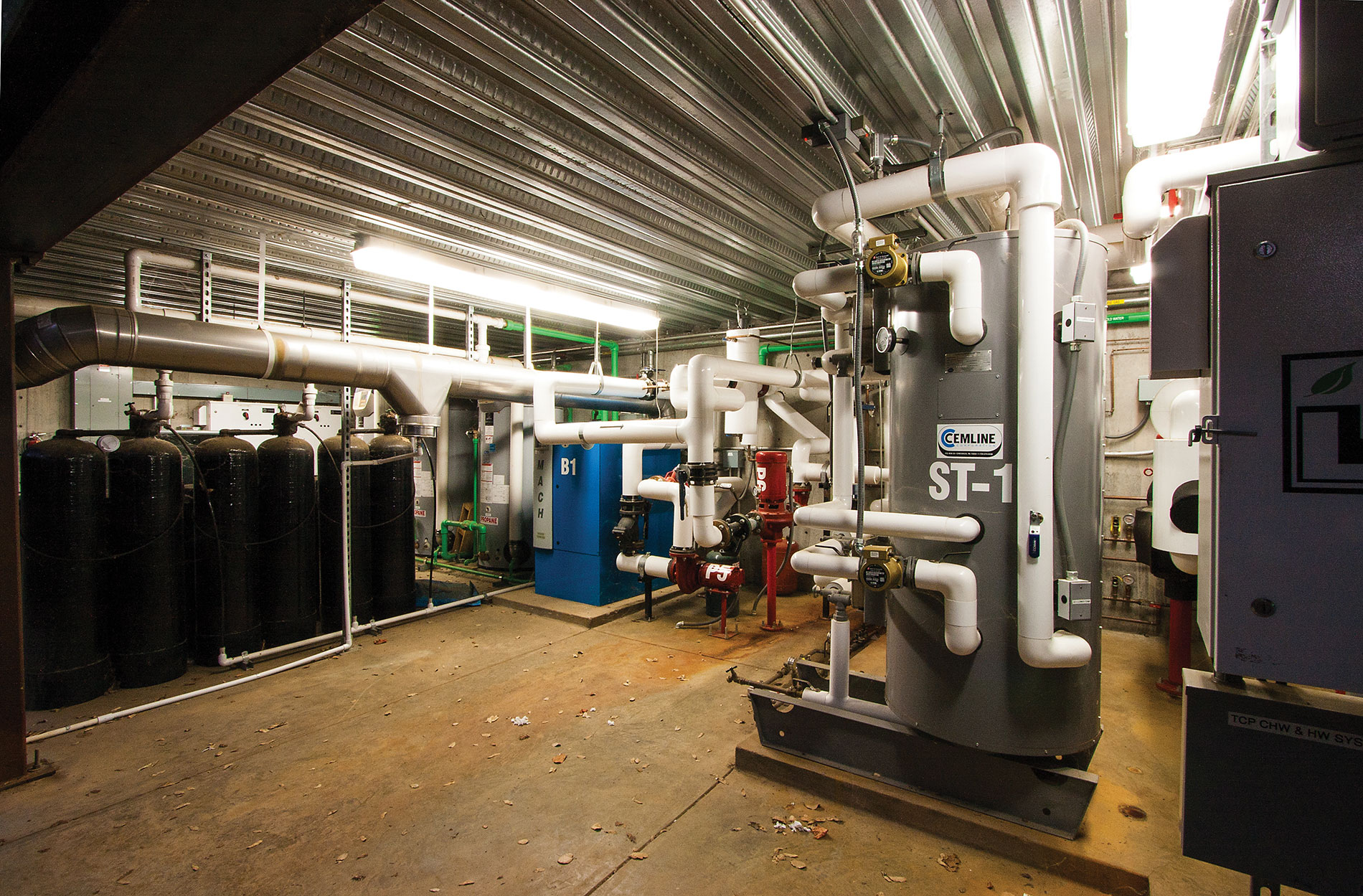 The equipment vault includes air compression, hot and chilled water, pumps and drives for fermentation room operation. Photo Credit: Grafton Electric
