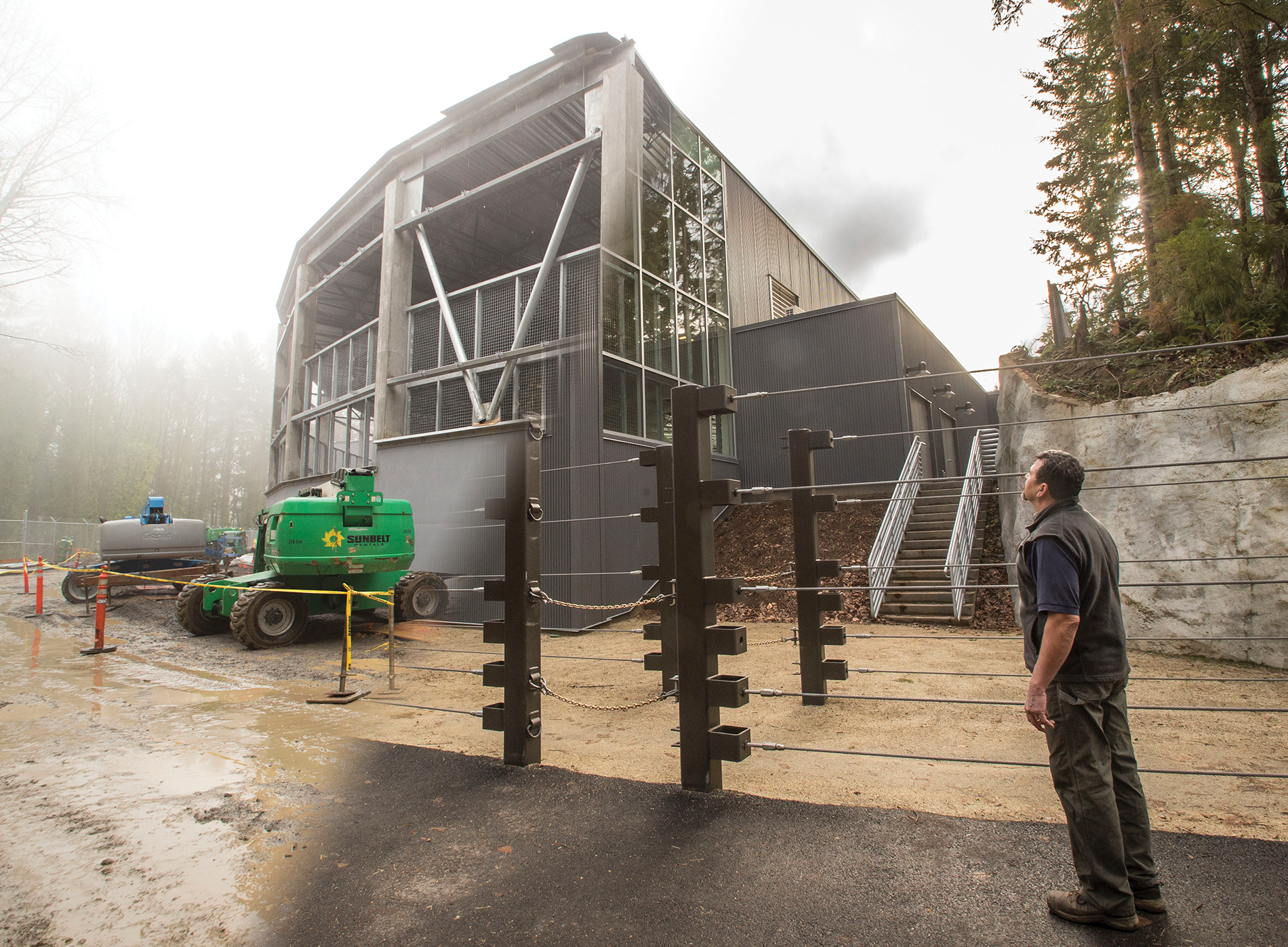 Keeper Gilbert Gomez checks out the exterior of Forest Hall from the Elephant Lands access road.