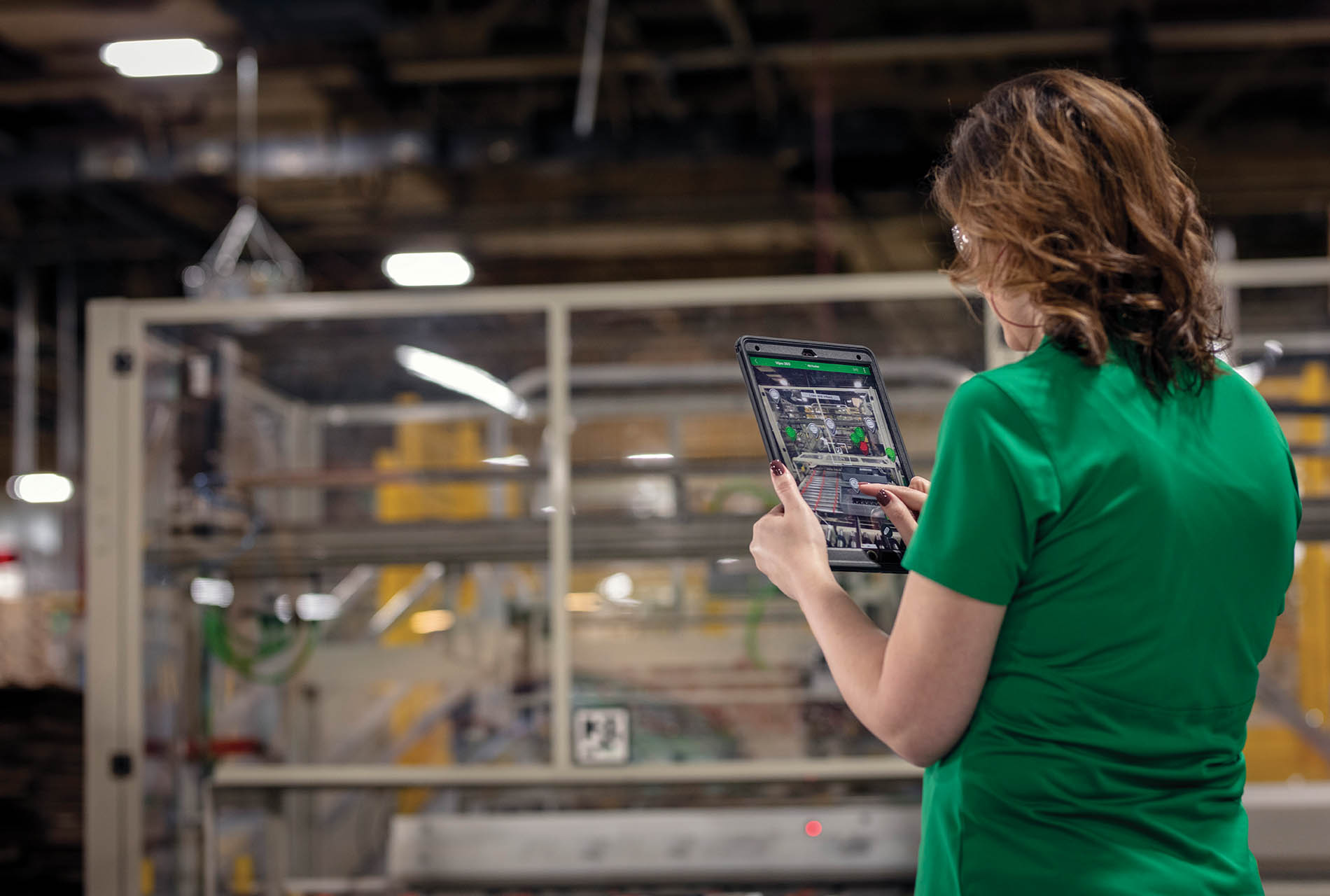 Workers at Schneider Electric's Lexington, Ky., smart factory use augmented reality to overlay machine information, which provides equipment details without exposing them to the hazard.