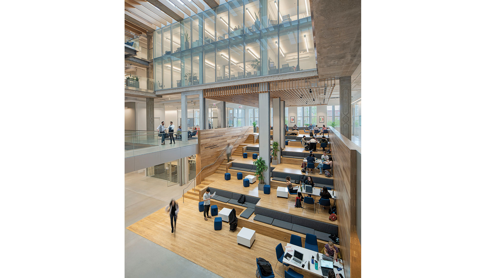 The three-story Harris Family Foundation King Harris Forum atrium required cutting through the building's central floors. A daylight harvesting systems helps marry natural lighting and LED fixtures to promote a healthy interior.