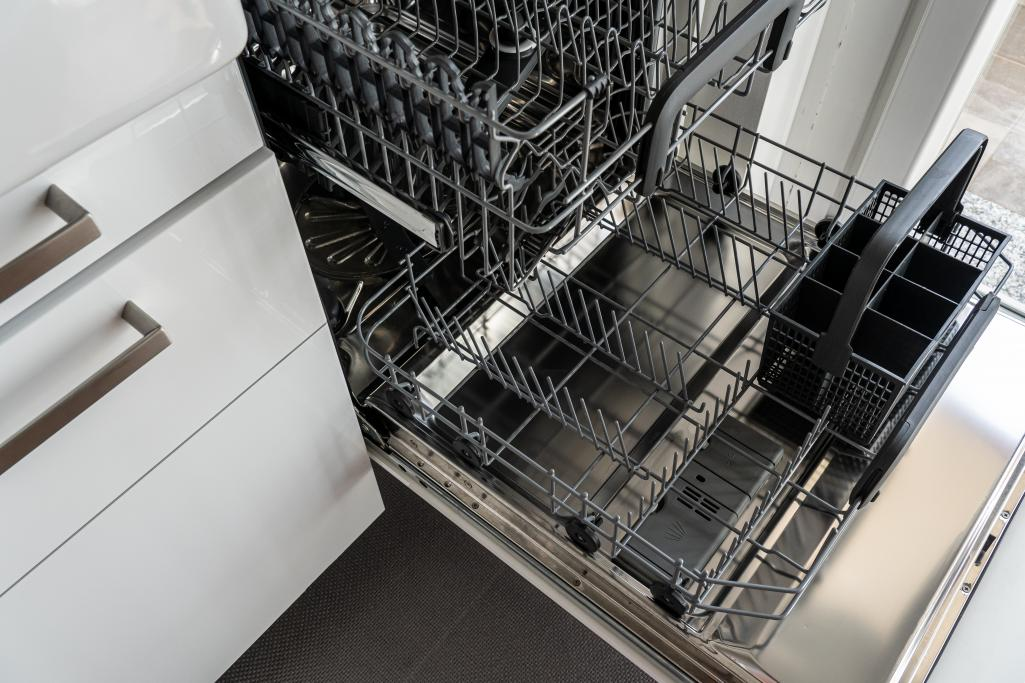 A dishwasher sits opened and empty