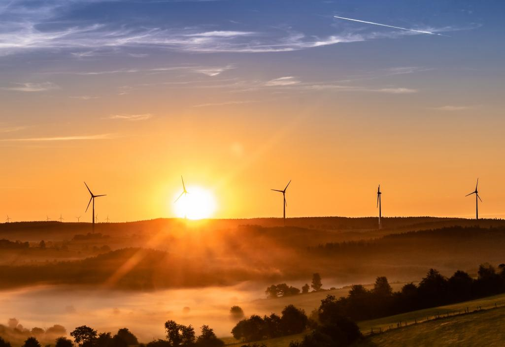 Wind power sunrise wind turbines Image by Myriam Zilles from Pixabay