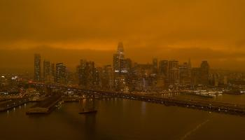 An orange, smoky sky caused by wildfires over San Francisco's financial district