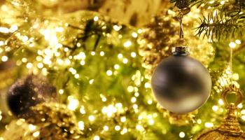 Close-up of a Christmas tree with lights (slightly unfocused) and decorations