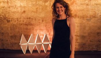 Jennifer Place stands with her winning luminaire design.