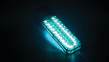Germicidal UV lamp glowing blue-green | Shutterstock / Nor Gal