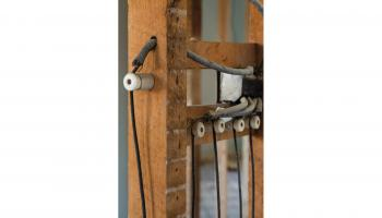 Knob-and-tube wiring on a residential renovation site | Shutterstock / Alessandro Cancian