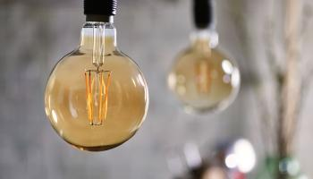 2 round bulbs hanging from the ceiling