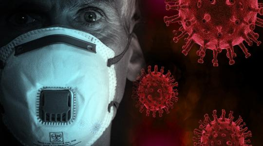 Man with N95 mask against a background of coronavirus