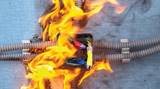 Electrical box and wires engulfed by fire. Shutterstock / Grigvovan