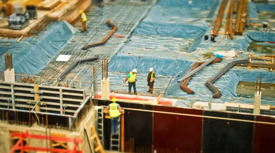 Men working at construction site.