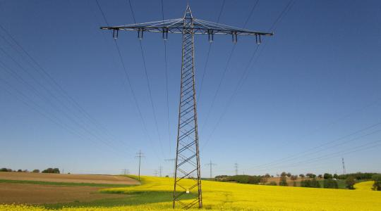 Utility tower in a rural field.