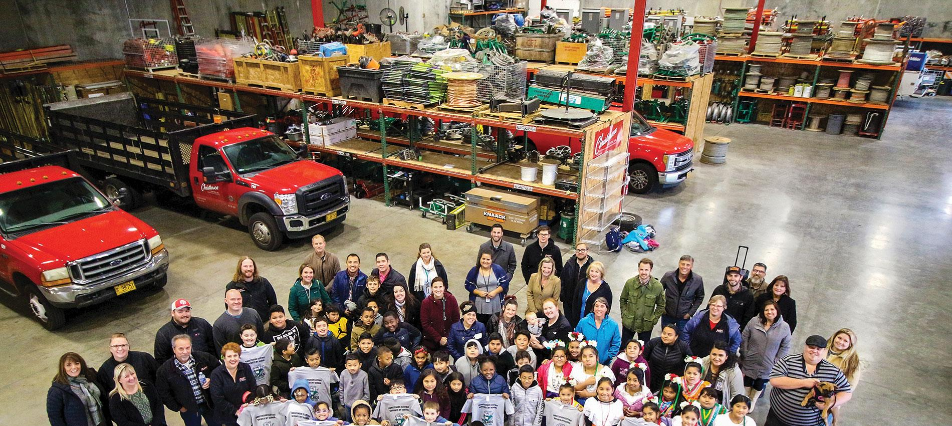 In Portland, Ore., team members from Christenson Electric pose with students from Wilkes Elementary School, a local institution they have supported with food, toys and daily-use items. Photo Credit: Christenson Electric
