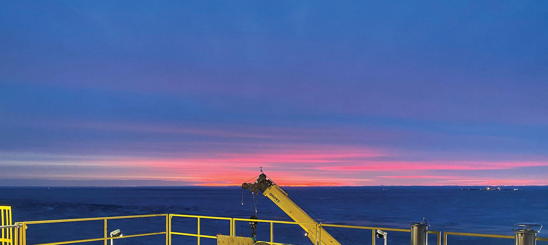 View of the twilight sky in Alaska at a construction site | Alcan Electrical / Bruce Davis