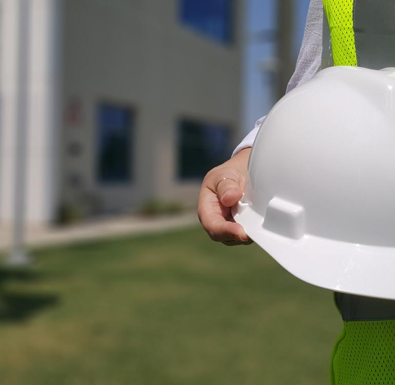 White construction hard hat worn for safety on construction sites.